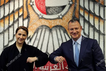 Minister of State for Food and Water Security Mariam al-Muhairi, left, and Erel Margalit, founder and chairman of Jerusalem Venture Partners, touch elbows after their meeting at the headquarter of the Government Accelerators in Dubai, United Arab Emirates, . Another plane full of Israeli business people excited about their newfound access to the UAE has touched down in Dubai this week. It's the latest whirlwind trip seeking to cash in on a U.S.-brokered deal to normalize relations between the countries