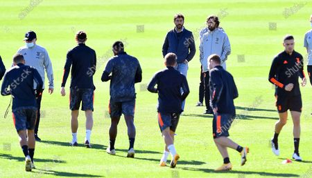 Stock Photo of Juventus' head coach Andrea Pirlo (back R) and the club's president Andrea Agnelli (back L) lead their team's training session at Continassa Centre in Turin, Italy, 27 October 2020. Juventus FC will face FC Barcelona in their UEFA Champions League group G soccer match on 28 October 2020.