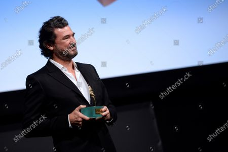Stock Picture of Julio Medem poses after receiving the Espiga de Honor (Honour spike) award at Valladolid International Film Festival, in Valladolid, Spain, 27 October 2020. The 65th SEMINCI runs from 24 to 31 October.
