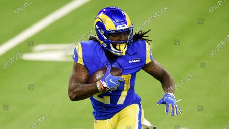 Los Angeles Rams running back Darrell Henderson runs against the Chicago Bears during the second half of an NFL football game, in Inglewood, Calif