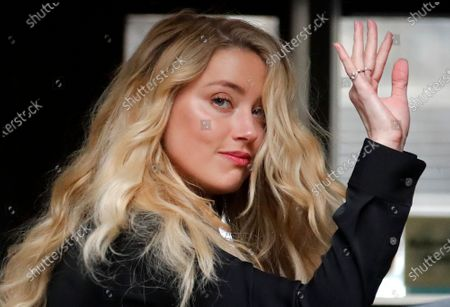 Stock Photo of Dated, US Actress Amber Heard, former wife of actor Johnny Depp, arrives at the High Court in London. Britain's judicial office said Tuesday Oct. 27, 2020, that judge Andrew Nicol will deliver his verdict in writing on Nov. 2, ruling on whether Johnny Depp was libelled by a tabloid newspaper that accused him of assaulting his then wife Amber Heard
