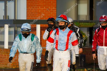 Stock Picture of Daryl Jacob in Kate and Andrew Brooks colours heading to the paddock at Bangor-on-Dee.