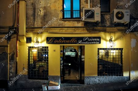 Exterior view of L'Intervallo Pizza Restaurant in the city centre. From Monday 26th October, according to a new decision of the Italian government, eateries must be closed at 18 pm. The measure, due to an increasing number of Covid-19 cases, is an addition to the curfew adopted by several region, including Calabria, from midnight to 5 a.m. and other measures in education and working sectors.