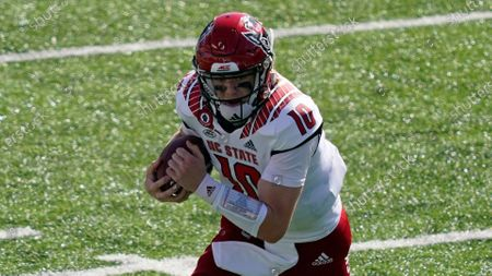 North Carolina State quarterback Ben Finley (10) runs against North Carolina during the first half of an NCAA college football game in Chapel Hill, N.C