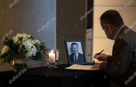 A member of parliament signs a book of condolence for Vice president of the German Parliament Bundestag Thomas Oppermann at the Reichstag building in Berlin, Germany, 27 October 2020. German Parliament Vice President Thomas Oppermann has died at the age of 66 after sudden collapsing while waiting for a live TV interview in the evening on 25 October.