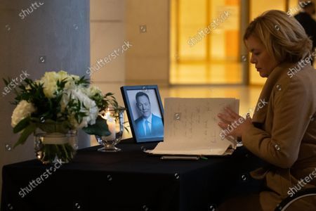 Stock Picture of German Minister of Food and Agriculture Julia Kloeckner looks at a book of condolence for Vice president of the German Parliament, Bundestag, Thomas Oppermann at the Reichstag building in Berlin, Germany, 27 October 2020. German Parliament Vice President Thomas Oppermann died at the age of 66 after suddenly collapsing while waiting for a live TV interview in the evening on 25 October.