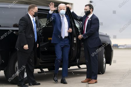 Democratic presidential candidate former Vice President Joe Biden arrives to board his campaign plane at New Castle Airport in New Castle, to travel to Georgia for rallies