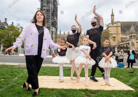 Stock Photo of Former Strictly Come Dancing judge Arlene Phillips yesterday called for more funding for the performing arts. The choreographer, pictured top, joined musicians and dancers, including girls in tutus, outside Parliament to highlight the plight of the live events industry and the workers at risk of losing their jobs. Miss Phillips, 77, said: 'Everyone in the performing arts is suffering from a loss of income, loss of respect, loss of performing, and most of all, the loss of the understanding that dance is a passion turned into a career only by years of punishing study harder than most athletes.' The Government. has announced a £1.57billion culture recovery fund for organisations including Shakespeare's Globe, Sadler's Wells and the Old Vic theatre. However, freelancers have said their livelihoods are still at risk and they may not benefit from the fund.