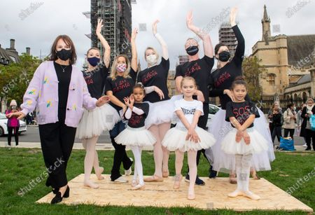 Former Strictly Come Dancing judge Arlene Phillips yesterday called for more funding for the performing arts. The choreographer, pictured top, joined musicians and dancers, including girls in tutus, outside Parliament to highlight the plight of the live events industry and the workers at risk of losing their jobs. Miss Phillips, 77, said: 'Everyone in the performing arts is suffering from a loss of income, loss of respect, loss of performing, and most of all, the loss of the understanding that dance is a passion turned into a career only by years of punishing study harder than most athletes.' The Government. has announced a £1.57billion culture recovery fund for organisations including Shakespeare's Globe, Sadler's Wells and the Old Vic theatre. However, freelancers have said their livelihoods are still at risk and they may not benefit from the fund.
