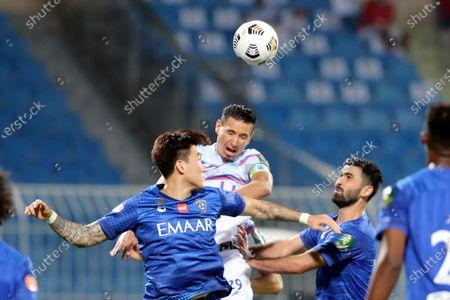 Al-Hilal's players Omar Kharbin (2-R) and Hyun Soo Jang (front-L) vie for the ball with Abha's Karim Aouadhi (back-L) during the Semi-finals of the King's Cup match between Al-Hilal and Abha at Prince Faisal Bin Fahd Stadium, Riyadh, Saudi Arabia, 27 October 2020.