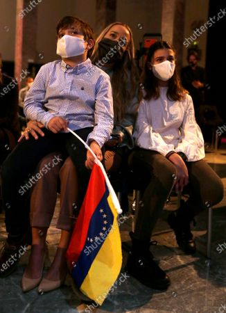 Lilian Tintori sits with her son and daughter, as she listens to her husband Leopoldo Lopez during a news conference in Madrid on . Prominent opposition activist Leopoldo López who has abandoned the Spanish ambassador's residence in Caracas and left Venezuela after years of frustrated efforts to oust the nation's socialist president is holding a news conference in Madrid