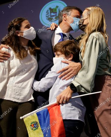 Venezuelan opposition leader Leopoldo Lopez kisses his wife Lilian Tintori with their son and daughter after a news conference in Madrid on . Prominent opposition activist Leopoldo López who has abandoned the Spanish ambassador's residence in Caracas and left Venezuela after years of frustrated efforts to oust the nation's socialist president is holding a news conference in Madrid