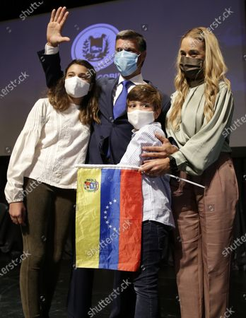 Venezuelan opposition leader Leopoldo Lopez with his wife Lilian Tintori and their son and daughter pose for a photo after a news conference in Madrid on . Prominent opposition activist Leopoldo López who has abandoned the Spanish ambassador's residence in Caracas and left Venezuela after years of frustrated efforts to oust the nation's socialist president is holding a news conference in Madrid