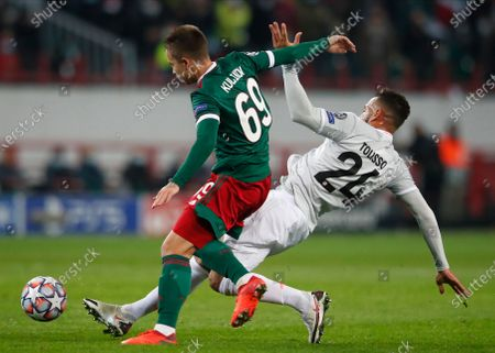 Lokomotiv's Daniil Kulikov (L) in action against Bayern's Corentin Tolisso (R) during the UEFA Champions League group A match between Lokomotiv Moscow and Bayern Munich in Moscow, Russia, 27 October 2020.