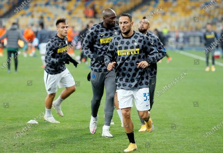 Danilo D'Ambrosio (front) of Inter warms up prior to the UEFA Champions League group B soccer match between FC Shakhtar Donetsk and FC Internazionale Milan in Kiev, Ukraine, 27 October 2020.
