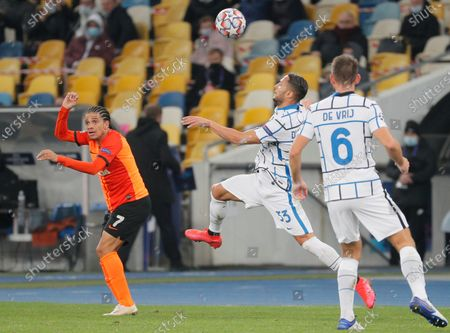 Stock Image of Danilo D'Ambrosio (C) of Inter and Taison (L) of Shakhtar in action during the UEFA Champions League group B soccer match between FC Shakhtar Donetsk and FC Internazionale Milan in Kiev, Ukraine, 27 October 2020.
