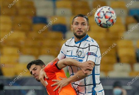 Danilo D'Ambrosio (R) of Inter and Manor Solomon (L) of Shakhtar in action during the UEFA Champions League group B soccer match between FC Shakhtar Donetsk and FC Internazionale Milan in Kiev, Ukraine, 27 October 2020.