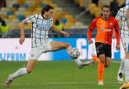 Stock Photo of Matteo Darmian (L) of Inter and Taison (R) of Shakhtar in action during the UEFA Champions League group B soccer match between FC Shakhtar Donetsk and FC Internazionale Milan in Kiev, Ukraine, 27 October 2020.