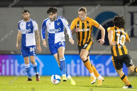 Stock Picture of Bristol Rovers defender Cian Harries (25) on the ball, chased by Hull City forward Tom Eaves (9) during the EFL Sky Bet League 1 match between Bristol Rovers and Hull City at the Memorial Stadium, Bristol