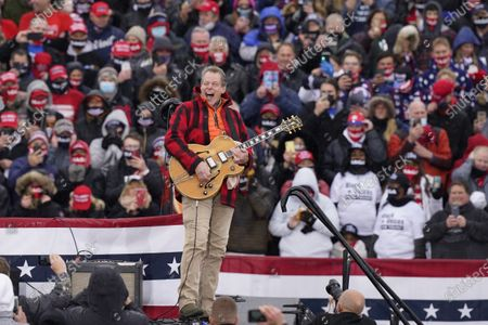 Musician Ted Nugent plays the national anthem before a President Donald Trump campaign event, in Lansing, Mich