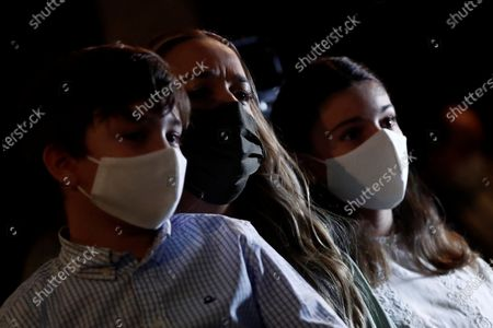 Lilian Tintori (C), wife of Venezuelan opposition leader Leopoldo Lopez, her son Leopoldo (R) and her daughter Manuela (R) attend a Lopez's press conference in Madrid, Spain, 27 October 2020. Leopoldo Lopez visits Spain after secretly fleeing his country via the Colombia border.