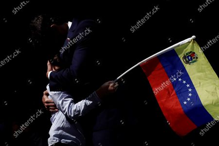 Venezuelan opposition leader Leopoldo Lopez (R) hugs his son Leopoldo (L) during a press conference in Madrid, Spain, 27 October 2020. Leopoldo Lopez visits Spain after secretly fleeing his country via the Colombia border.