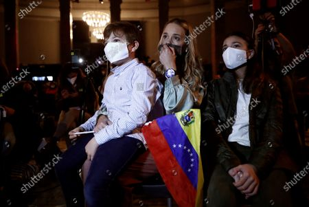 Lilian Tintori (C), wife of Venezuelan opposition leader Leopoldo Lopez, her son Leopoldo and her daughter Manuela attend a Lopez's press conference in Madrid, Spain, 27 October 2020. Leopoldo Lopez visits Spain after secretly fleeing his country via the Colombia border.