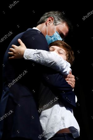 Stock Image of Venezuelan opposition leader Leopoldo Lopez (L) hugs his son Leopoldo (R) during a press conference in Madrid, Spain, 27 October 2020. Leopoldo Lopez visits Spain after secretly fleeing his country via the Colombia border.