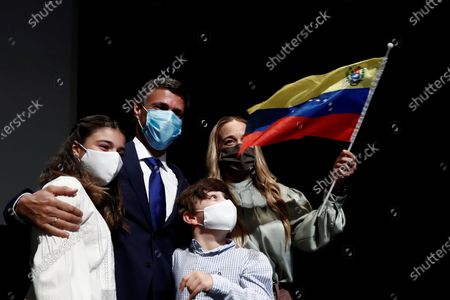 Venezuelan opposition leader Leopoldo Lopez (2-L), his wife Lilian Tintori (R), his son Leopoldo (2-R) and his daughter Manuela (L) pose for the media after a press conference in Madrid, Spain, 27 October 2020. Leopoldo Lopez visits Spain after secretly fleeing his country via the Colombia border.