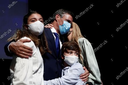 Stock Picture of Venezuelan opposition leader Leopoldo Lopez (2-L), his wife Lilian Tintori (R), his son Leopoldo (2-R) and his daughter Manuela (L) pose for the media after a press conference in Madrid, Spain, 27 October 2020. Leopoldo Lopez visits Spain after secretly fleeing his country via the Colombia border.