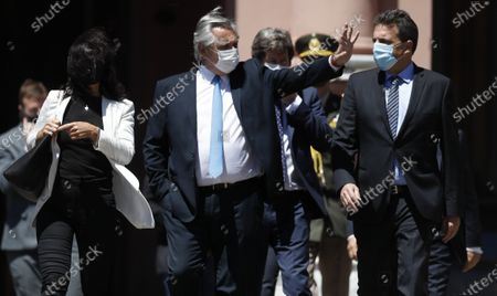 President Alberto Fernandez, wearing a mask amid the COVID-19 pandemic, leaves the government house for a ceremony honoring late President Nestor Kirchner on the 10-year anniversary of his death in Buenos Aires, Argentina, . Kirchner's widow, Cristina Fernandez, is the current vice president