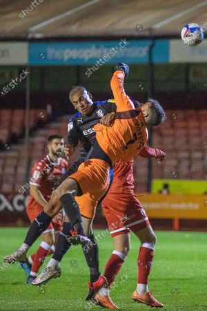 James Vaughan, Forward with Tranmere Rovers FC (9) collides with Glenn Morris, Goalkeeper with Crawley Town (1) during the EFL Sky Bet League 2 match between Crawley Town and Tranmere Rovers at The People's Pension Stadium, Crawley