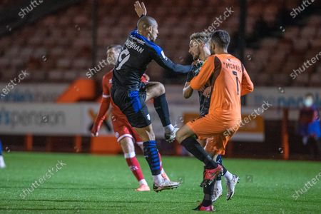 Glenn Morris, Goalkeeper with Crawley Town (1) saves the ball as James Vaughan, Forward with Tranmere Rovers FC (9) comes up close during the EFL Sky Bet League 2 match between Crawley Town and Tranmere Rovers at The People's Pension Stadium, Crawley