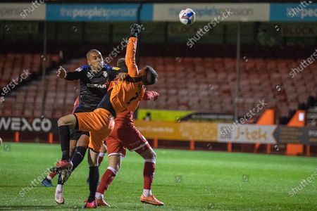 Stock Photo of James Vaughan, Forward with Tranmere Rovers FC (9) collides with Glenn Morris, Goalkeeper with Crawley Town (1) during the EFL Sky Bet League 2 match between Crawley Town and Tranmere Rovers at The People's Pension Stadium, Crawley