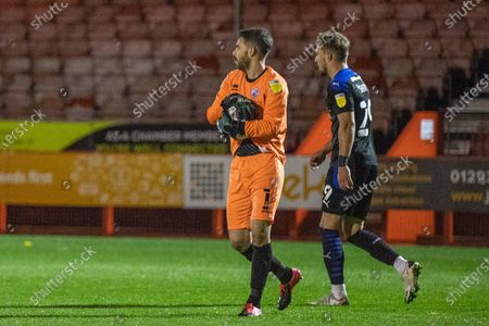 Glenn Morris, Goalkeeper with Crawley Town (1) & Sam Smith, Forward with Tranmere Rovers FC (29) during the EFL Sky Bet League 2 match between Crawley Town and Tranmere Rovers at The People's Pension Stadium, Crawley