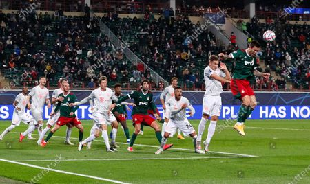 Lokomotiv's Fyodor Smolov, right, heads the ball during the Champions League group A soccer match between Lokomotiv Moscow and Bayern Munich in Moscow, Russia