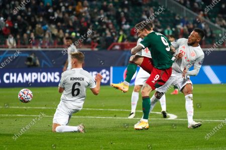 Lokomotiv's Fyodor Smolov kicks the ball ahead of Bayern's Joshua Kimmich during the Champions League group A soccer match between Lokomotiv Moscow and Bayern Munich in Moscow, Russia