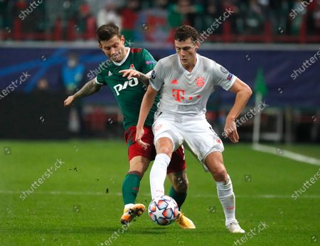 Lokomotiv's Fyodor Smolov, left, and Bayern's Benjamin Pavard challenge for the ball during the Champions League group A soccer match between Lokomotiv Moscow and Bayern Munich in Moscow, Russia