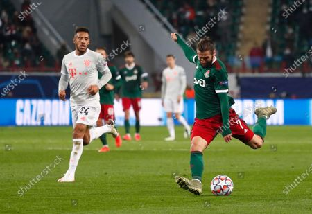 Lokomotiv's Grzegorz Krychowiak kicks the ball ahead of Bayern's Corentin Tolisso during the Champions League group A soccer match between Lokomotiv Moscow and Bayern Munich in Moscow, Russia