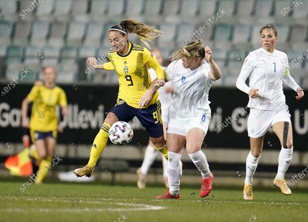 Sweden's Kosovare Asllani (L) battles with Iceland's Ingibjorg Sigurardottir (R) during the UEFA Women's EURO 2022 qualifying match between Sweden and Iceland at Old Ullevi Arena in Gothenburg, Sweden, 27 October 2020.