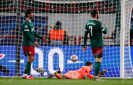 Lokomotiv's goalkeeper Guilherme (C), Vedran Corluka (L) and Grzegorz Krychowiak (R) react after conceding the 0-1 goal during the UEFA Champions League group A match between Lokomotiv Moscow and Bayern Munich in Moscow, Russia 27 October 2020.