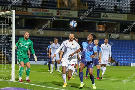 Wycombe Wanderers defender Anthony Stewart (5) on the ball challenged by Watford midfielder Etienne Capoue (29) during the EFL Sky Bet Championship match between Wycombe Wanderers and Watford at Adams Park, High Wycombe