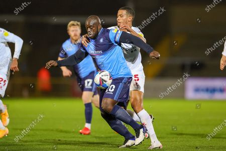 Watford defender William Troost-Ekong (5) tussles with Wycombe Wanderers forward Adebayo Akinfenwa (20) during the EFL Sky Bet Championship match between Wycombe Wanderers and Watford at Adams Park, High Wycombe