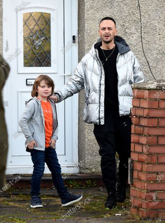 Stock Image of Joseph Gilgun with 9 year old actor Jude Riordan who has just landed a role in Coronation Street.