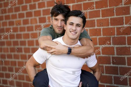 TikTok personalities Ian Paget, left, and Chris Olsen pose for a portrait in West Hollywood, Calif. on . Paget and Olsen, gay partners in Los Angeles, have amassed more than 4 million followers who love and encourage them as they hunker down at home, churning out goofy dance videos and playing the constant pranks that are stock-in-trade on TikTok