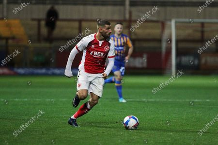 Ched Evans of Fleetwood Town runs with the ball  during the EFL Sky Bet League 1 match between Fleetwood Town and Shrewsbury Town at the Highbury Stadium, Fleetwood