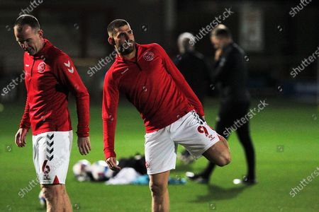 Ched Evans of Fleetwood Town stretches during the warm up  before the EFL Sky Bet League 1 match between Fleetwood Town and Shrewsbury Town at the Highbury Stadium, Fleetwood