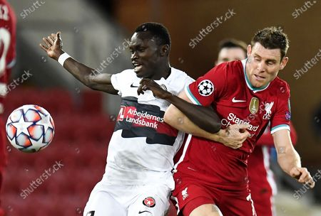 Pione Sisto (L) of Midtjylland in action against James Milner (R) of Liverpool during the UEFA Champions League group D match between Liverpool and Midtjylland in Liverpool, Britain, 27 October 2020.