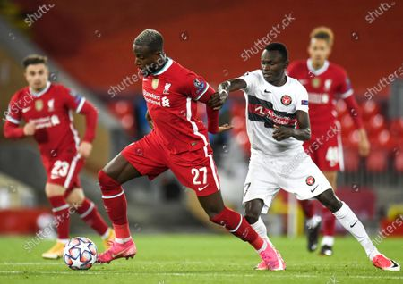 Divock Origi (L) of Liverpool in action against Pione Sisto (R) of Midtjylland during the UEFA Champions League group D match between Liverpool and Midtjylland in Liverpool, Britain, 27 October 2020.