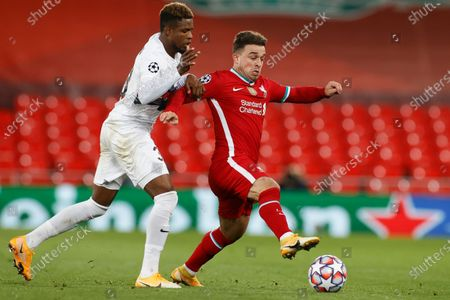 Liverpool's Xherdan Shaqiri, right, and Midtjylland's Frank Onyeka vie for the ball during the Champions League Group D soccer match between Liverpool and FC Midtjylland at Anfield stadium, in Liverpool, England